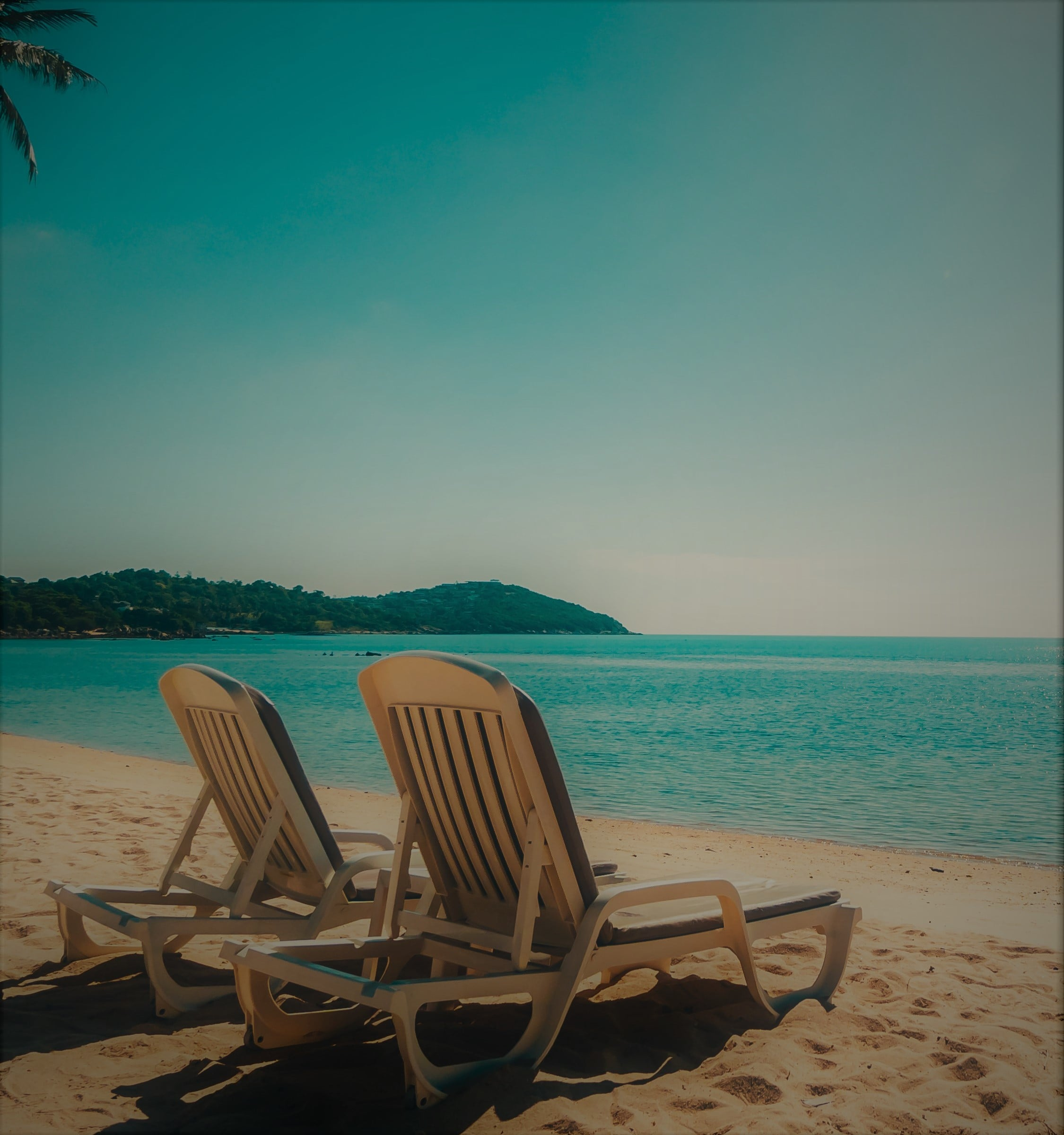 beautiful-tropical-beach-and-sea-with-chair-on-blue-sky-min.jpg
