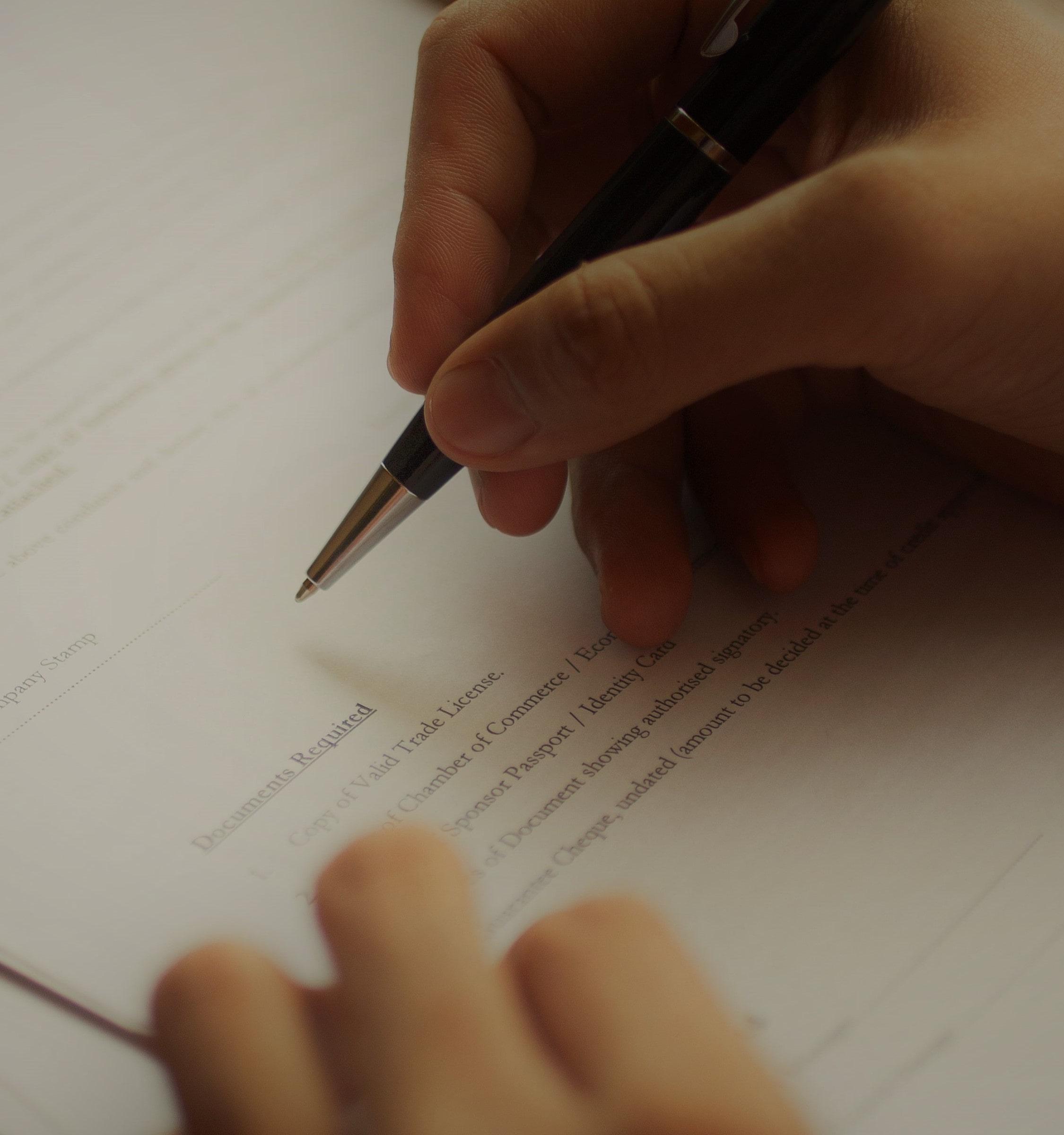 businessman-examining-papers-at-table-min-min.jpg